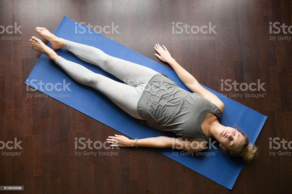Yoga at home: resting posture stock photo