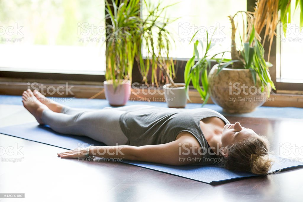 Yoga at home: Shavasana Pose stock photo