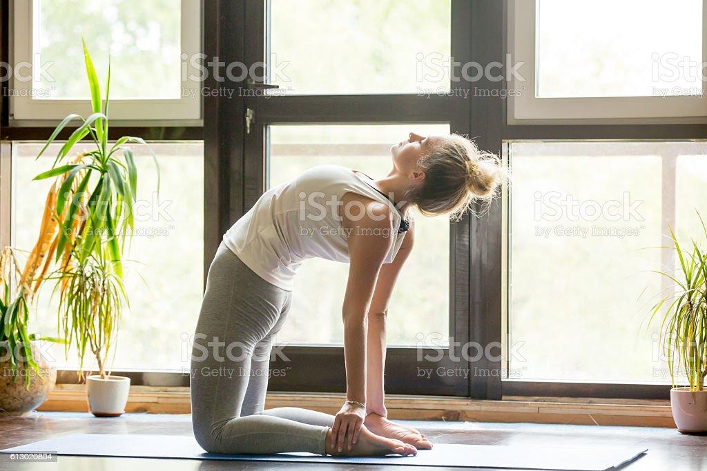 Yoga at home: Ustrasana Pose stock photo