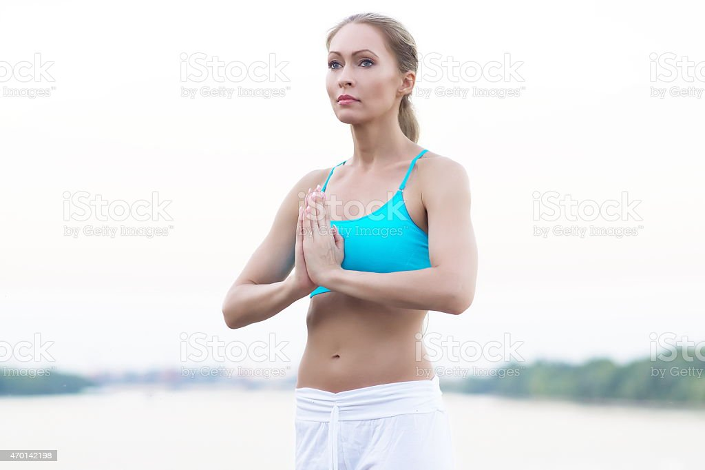 Yoga at river side stock photo