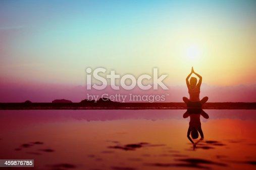istock yoga at sunset 459876785