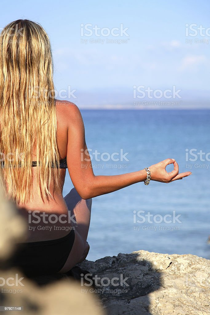 Yoga at the beach royalty-free stock photo
