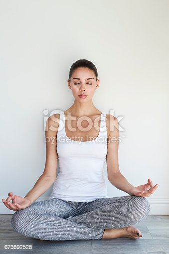 Beautiful woman in yoga pose, content