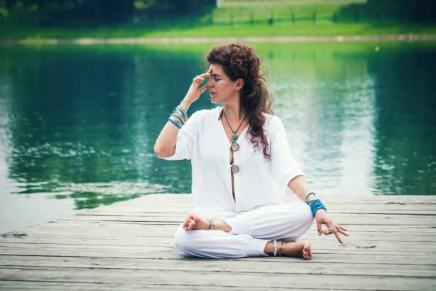 yoga breathing techniques stock photo