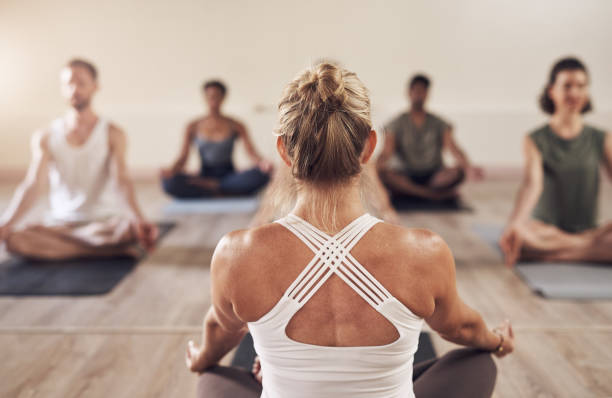 Yoga brings balance to our lives stock photo