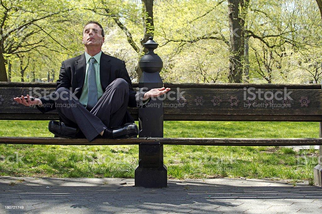 Yoga businessman bench royalty-free stock photo