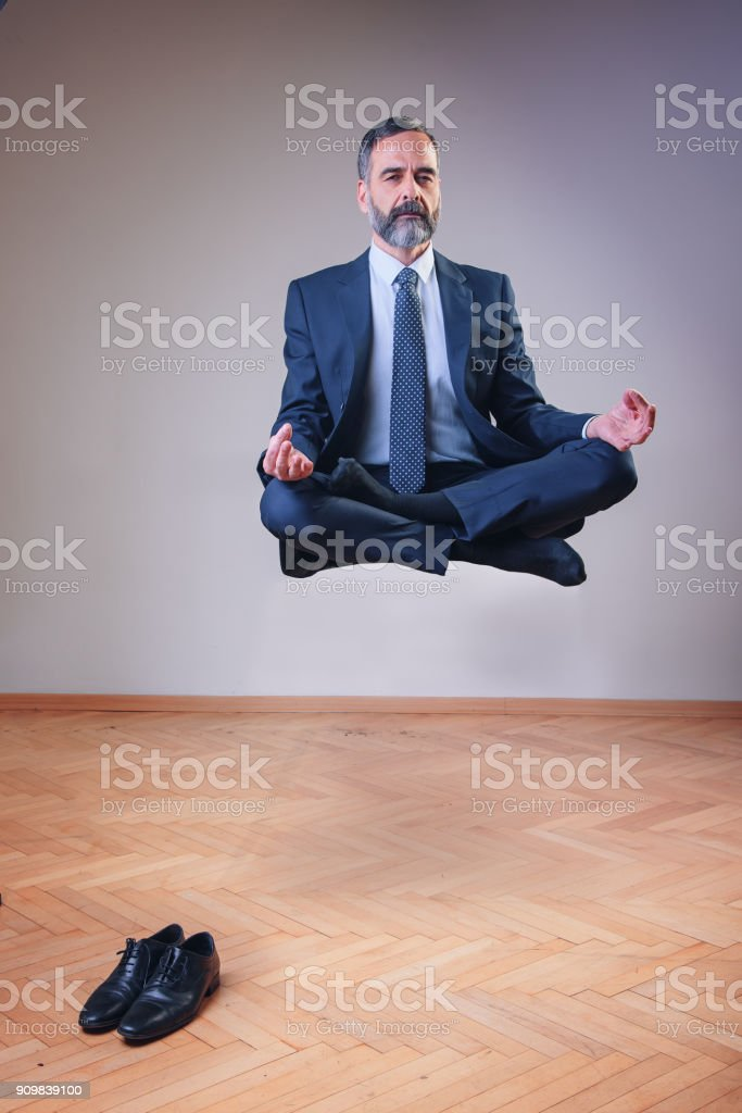 Yoga Businessman Floating In The Air Royalty Free Stock Photo
