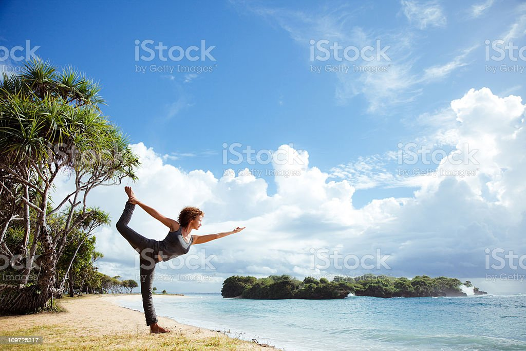 yoga by ocean royalty-free stock photo
