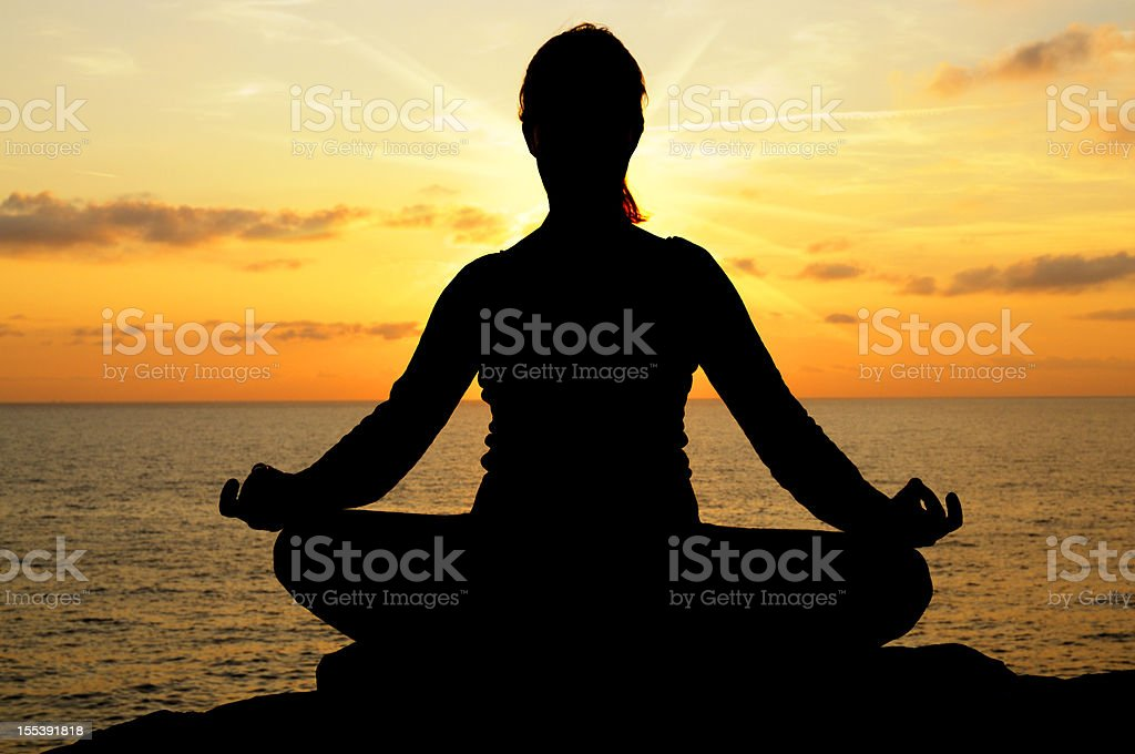 Yoga by the Sea at Sunset royalty-free stock photo