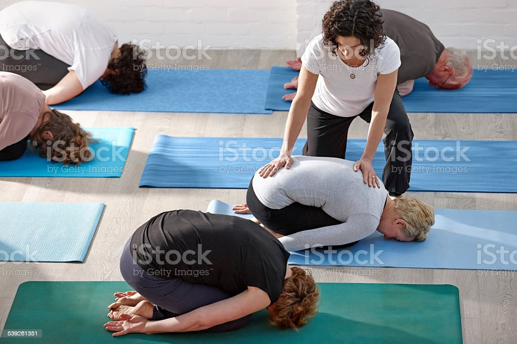 Yoga class at fitness club stock photo