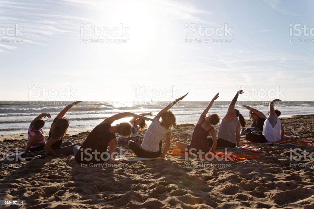 Yoga class by the sea stock photo