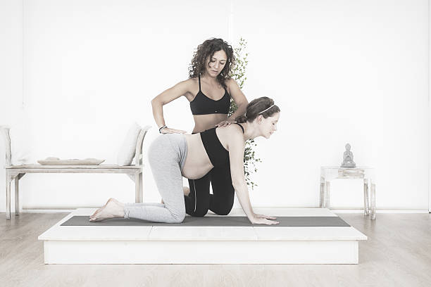 Yoga class for pregnant woman stock photo