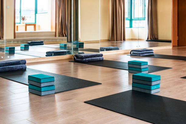 Yoga Class Interior Empty yoga studio ready for students. yoga studio stock pictures, royalty-free photos & images