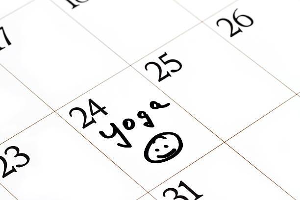 yoga class marked on calendar - calendar workout bildbanksfoton och bilder