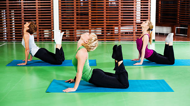 royalty free yoga class yoga instructor yoga three people pictures