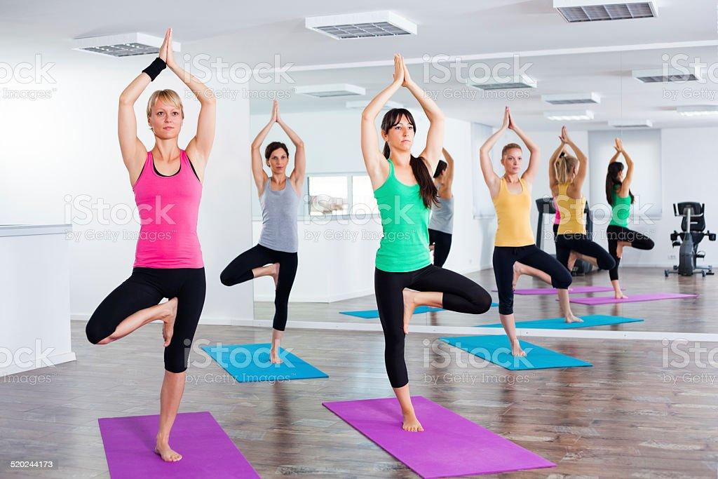 Yoga class - Tree pose/Vrikshasana stock photo