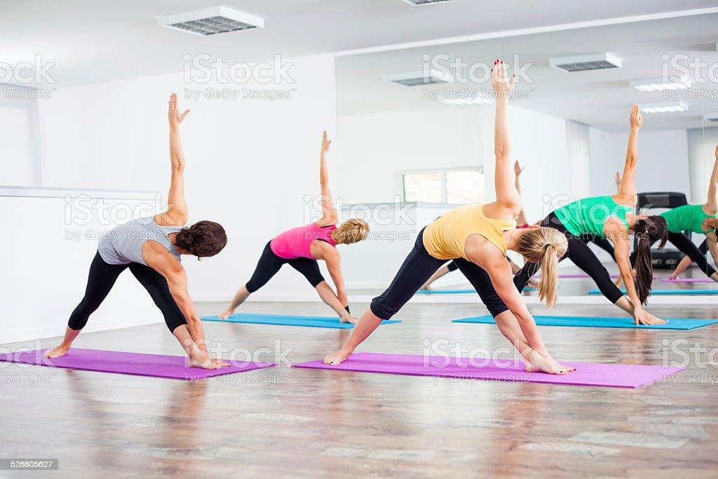 Yoga class - Trikonasana Bikram/Bikram triangle right stock photo