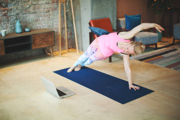 Yoga classes with laptop stock photo