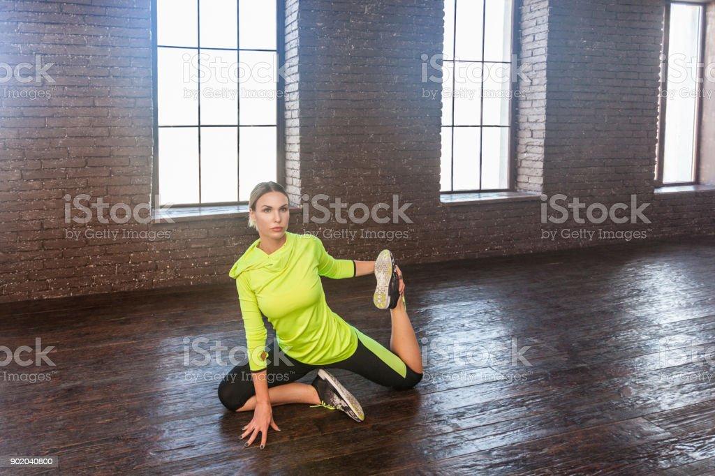Yoga concept. Asana, kapotasana king. Fitnes woman doing gymnastics stock photo