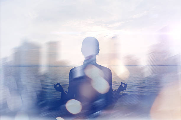 Yoga concept. Double exposure. Woman doing yoga practice stock photo
