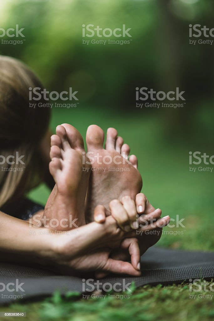 Yoga detail from seated foward bend position stock photo
