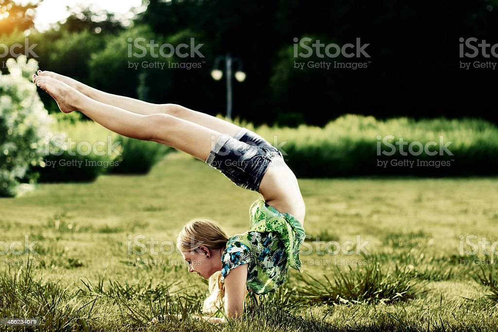 Yoga exercise in the park royalty-free stock photo