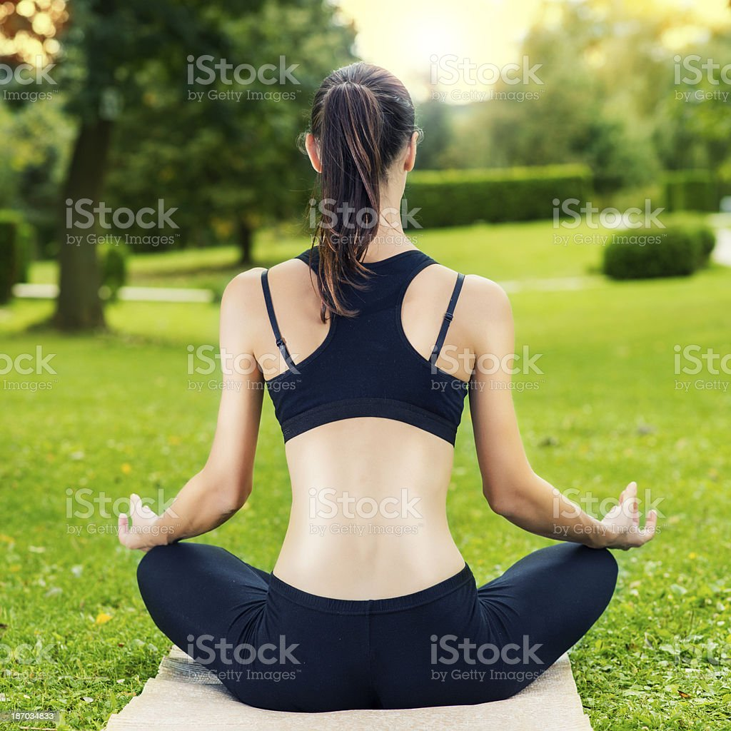 Yoga exercise in the sunset royalty-free stock photo