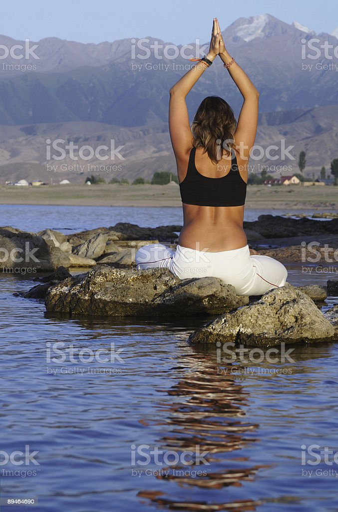 yoga exercise on beach royalty-free stock photo