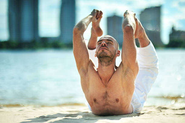 Yoga exercise (beach) stock photo