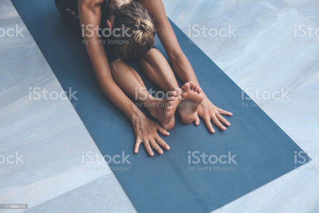 Yoga exercises at home Yoga exercises at home 20-29 Years Stock Photo