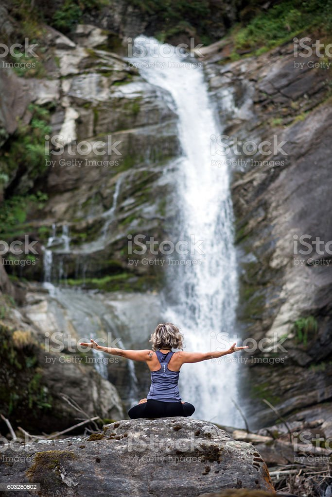 Yoga exercises in nature: Padmasana or lotus position stock photo