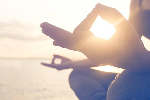 yoga exercises seafront - hand tänder ett ljus bildbanksfoton och bilder