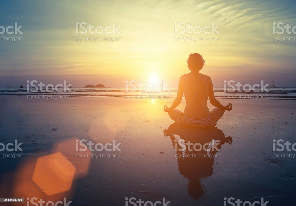 Yoga, fitness and healthy lifestyle. Silhouette meditation girl stock photo
