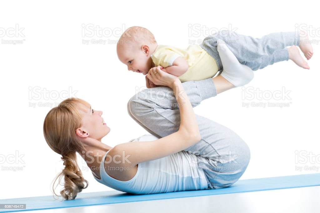 Yoga for woman and baby. Mother with child boy doing stock photo