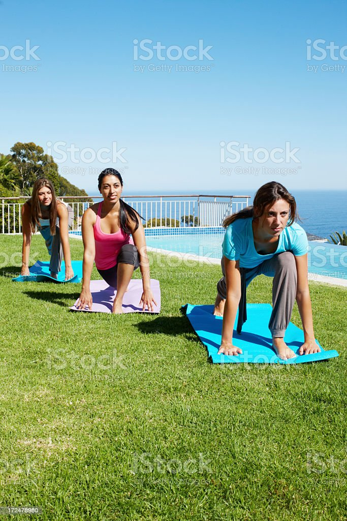 Yoga gathering of friends royalty-free stock photo