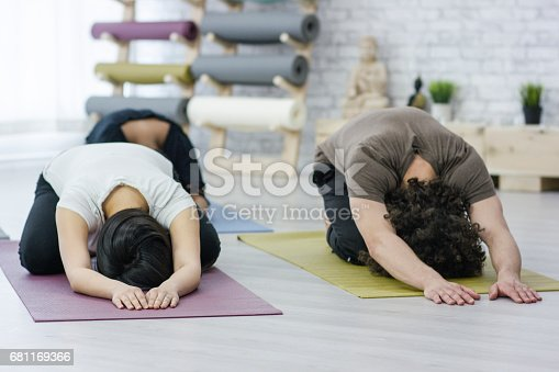 637804152istockphoto Yoga Group Doing Child's Pose 681169366