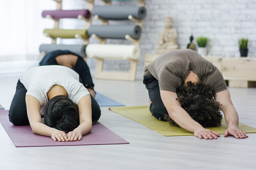 637804152 istock photo Yoga Group Doing Child's Pose 681169366