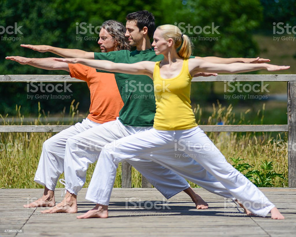 yoga group three people frontal view stock photo