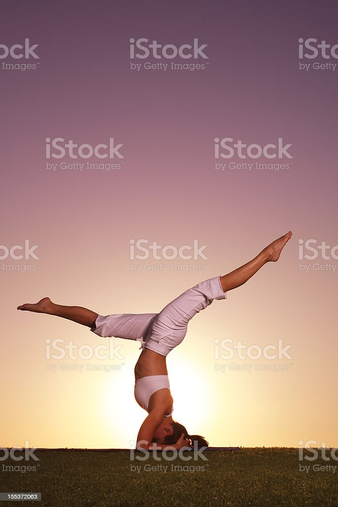 Yoga Headstand at Sunset royalty-free stock photo