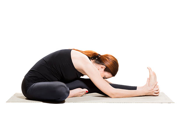 Yoga Head-to-Knee Forward Bend - Janu Sirsasana Yoga Head-to-Knee Forward Bend - Janu Sirsasana new age music stock pictures, royalty-free photos & images