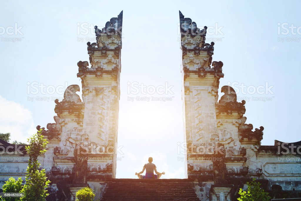 yoga in Bali, meditation in the temple, spirituality concept stock photo