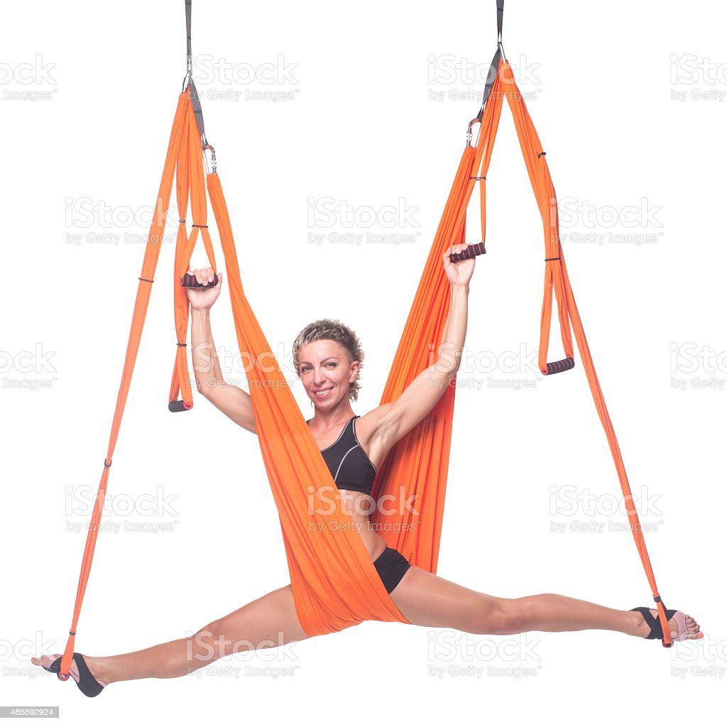 Yoga in Hammock, sky yoga, Fly Yoga. Antigravity stock photo