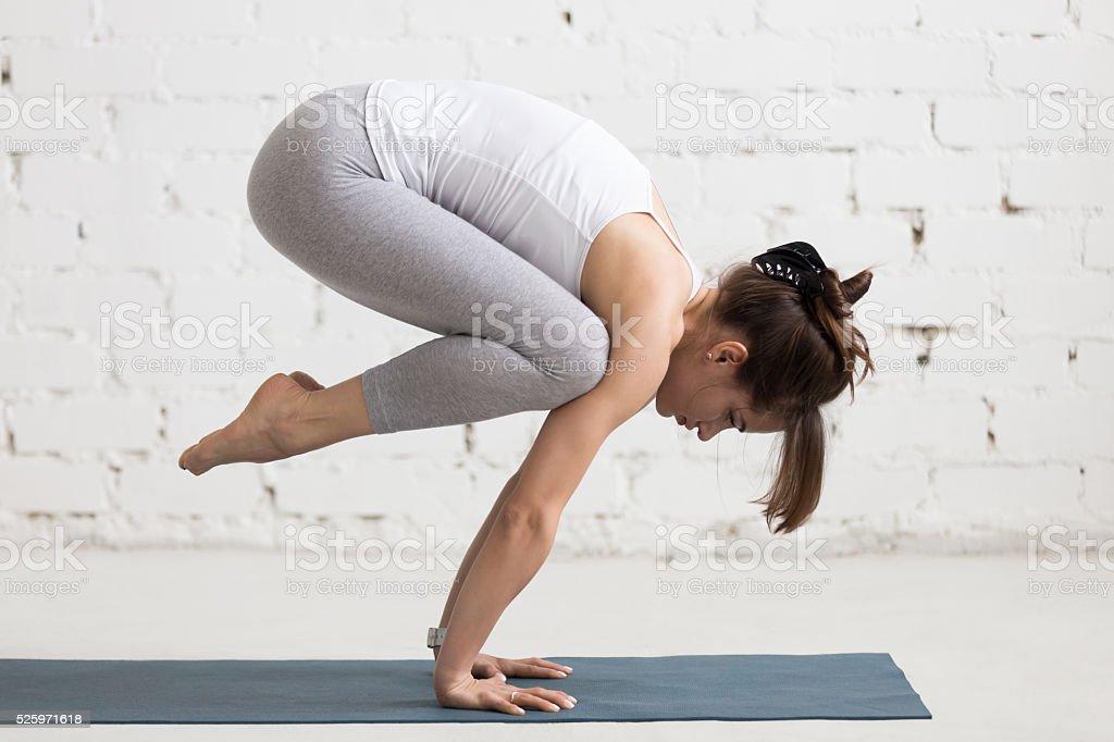 Yoga Indoors: Bakasana stock photo