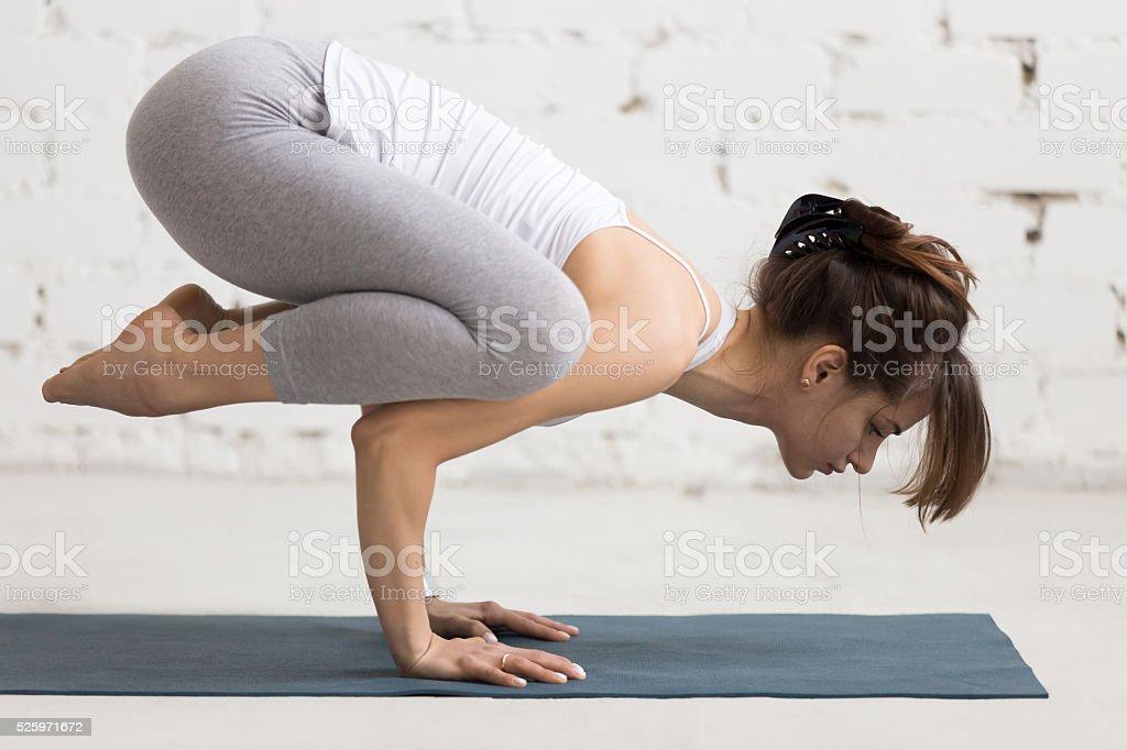 Yoga Indoors: Crane Pose stock photo