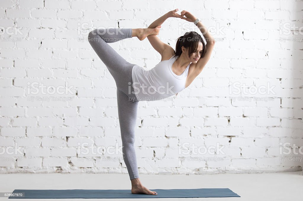 Yoga Indoors: Lord of the Dance Pose stock photo