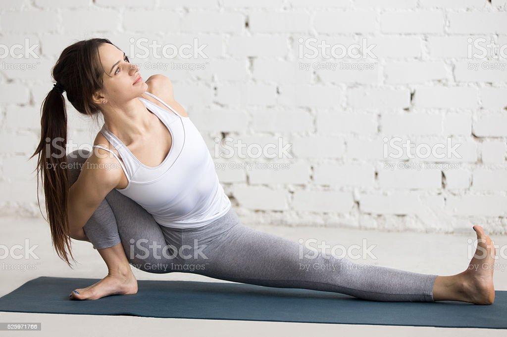 Yoga Indoors: Parivrtta Janu Sirsasana stock photo