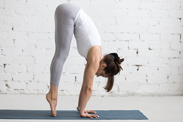 Yoga Indoors: preparation for Handstand pose stock photo