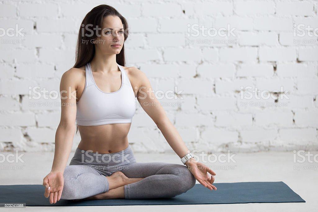 Yoga Indoors: Sukhasana pose stock photo