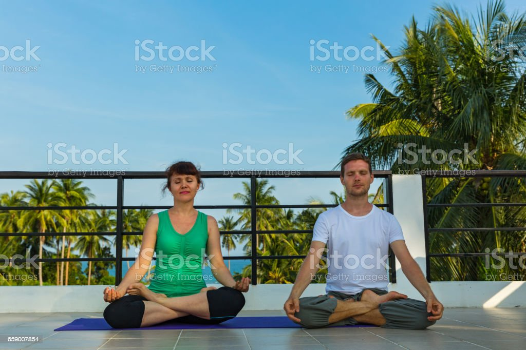 Yoga instructor and  woman royalty-free stock photo