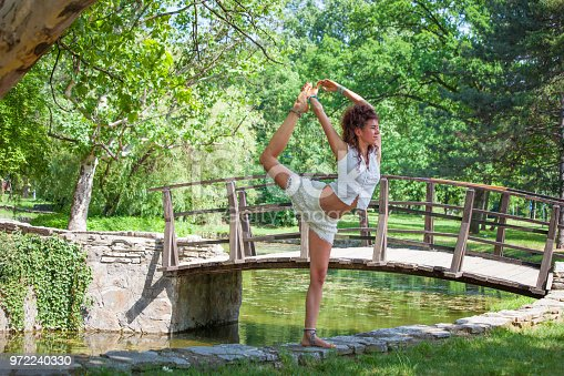 istock yoga instructor outdoor 972240330